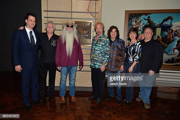 Country Music Hall of Fame Editor Peter Cooper Musicians Joe Bonsall William Lee Golden Duane Allen and Richard Sterban of The Oak Ridge Boys Country...