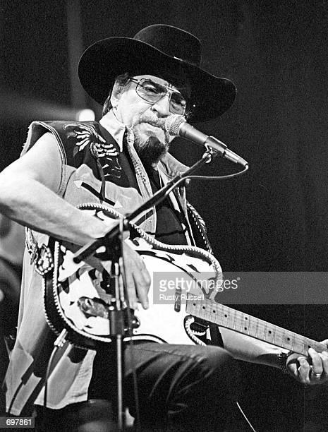 Country music legend Waylon Jennings performs live at Nashvilles Ryman Auditorium January 5 2000 in Nashville TN Jennings died February 13 2002 at...