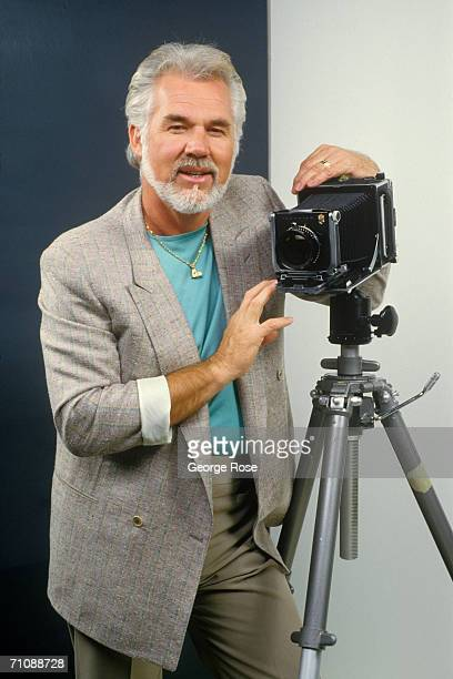 Country music singer actor and photographer Kenny Rogers poses during a 1986 Los Angeles California studio portrait session Rogers was promoting his...