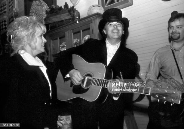 Country music singer and musician Marty Stuart and his wife country music singer Connie Smith harmonize at an informal 2001 performance in an antique...