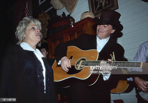 Country music singer and musician Marty Stuart performs with his wife veteran country music singer Connie Smith in 2001 at an informal performance...
