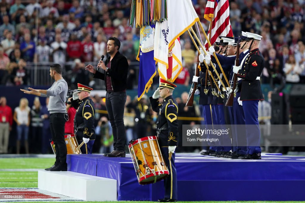 Country music singer and songwriter Luke Bryan performs the national anthem prior to Super Bowl 51 between the New England Patriots and the Atlanta Falcons at NRG Stadium on February 5, 2017 in Houston, Texas.