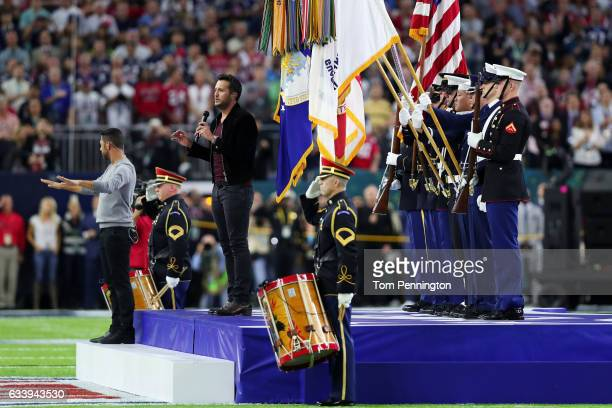 Country music singer and songwriter Luke Bryan performs the national anthem prior to Super Bowl 51 between the New England Patriots and the Atlanta...