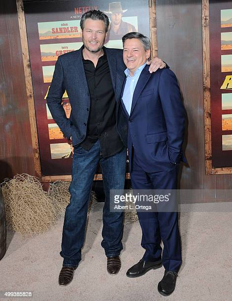 Country music singer Blake Shelton and Ted Sarandos Chief Content Officer of Netflix arrive for the premiere of Netflix's 'The Ridiculous 6' held at...