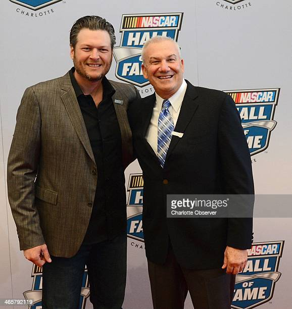 Country music singer Blake Shelton left poses with NASCAR Hall of Fame inductee Dale Jarrett during the NASCAR Hall of Fame Induction Ceremony in...