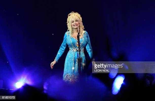 US country music singer Dolly Parton performs onstage in London as part of her Backwoods Barbie world tour on July 5 2008 The tour will see her...