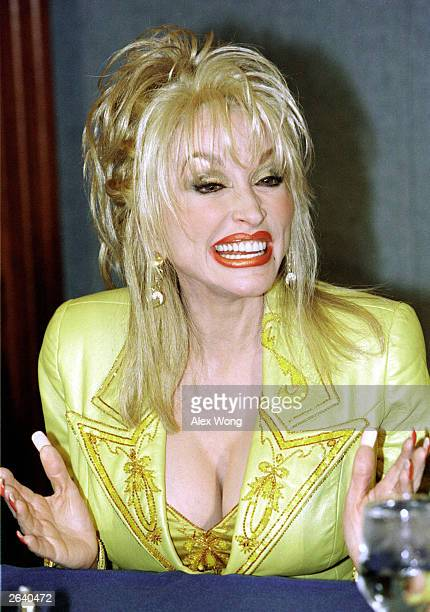 Country music singer Dolly Parton smiles during the National Press Club luncheon in Washington DC March 23 2000 Parton announced today that she is...