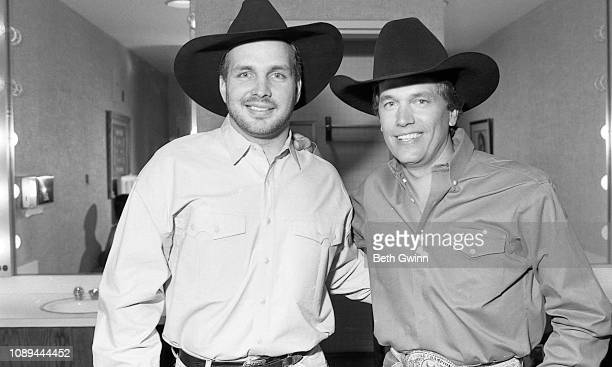 Country Music Singer Garth Brooks and George Strait back stage at the Grand ole Opry house March 71991 in Nashville Tennessee