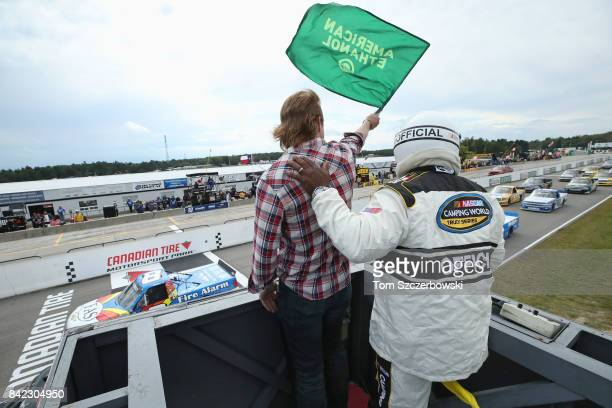 Country music singer Jade Eagleson waves the green flag to start the race at Canadian Tire Mosport Park on September 3 2017 in Bowmanville Canada