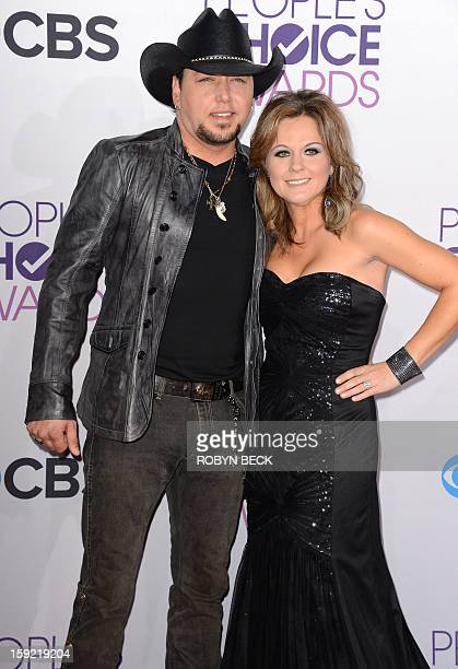 Country music singer Jason Aldean arrives with his wife Jessica Aldean for the 2013 People's Choice Awards at the Nokia Theatre in Los Angeles,...