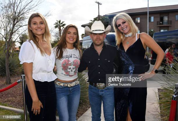 Country music singer Juntin Moore and Hannah Mulholland Naomi Cooke and Jennifer Wayne of musical group Runaway June pose for a photo backstage at...