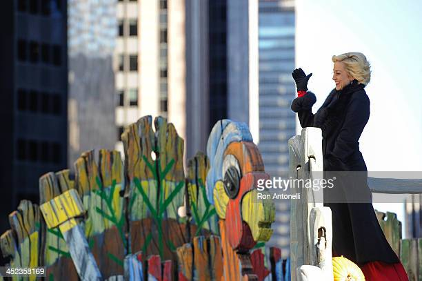 Country music singer Kellie Pickler waves to people watching on the street from the Discover and NHL's Frozen Fall Fun float in the 87th Annual...