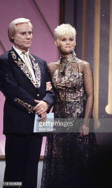 Country Music Singer Songwriter George Jones Lori Morgan presenter's at CMA Award show on September 28 1991 in Nashville Tennessee