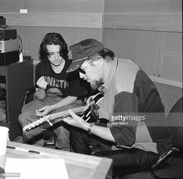 Country Music Singer Songwriter Shooter Jennings with his father Waylon Jennings in the studio October 161995 NashvilleTennessee
