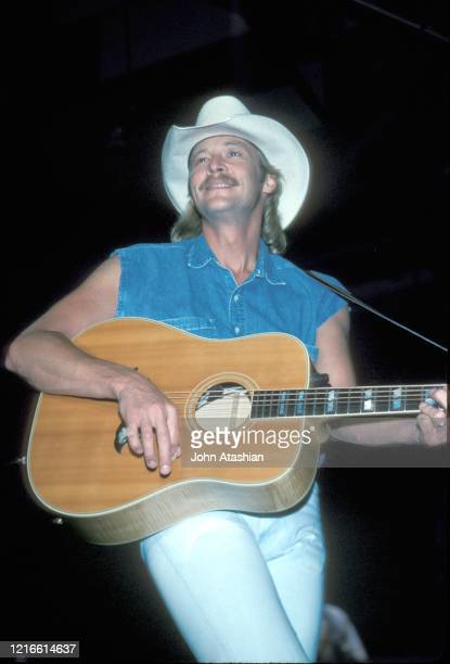 """Country music star Alan Jackson is shown performing on stage during a """"live"""" concert appearance on May 21, 1993."""