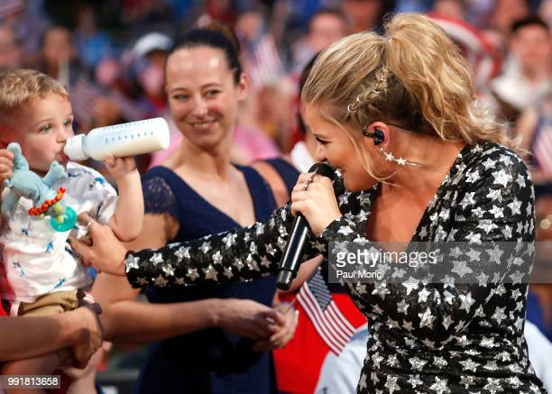 Country music star and AMERICAN IDOL alum Lauren Alaina tickles a baby in the audience as she performs at the 2018 A Capitol Fourth at the US Capitol...