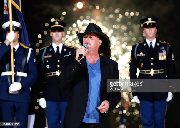 Country music star and Grammynominated member of the Grand Ole Opry Trace Adkins performs during the fireworks finale at A Capitol Fourth at US...