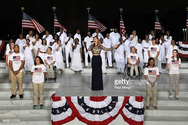 Country music star Cassadee Pope onstage with members of the US Olympic and Paralympic Team at A Capitol Fourth concert at the US Capitol West Lawn...