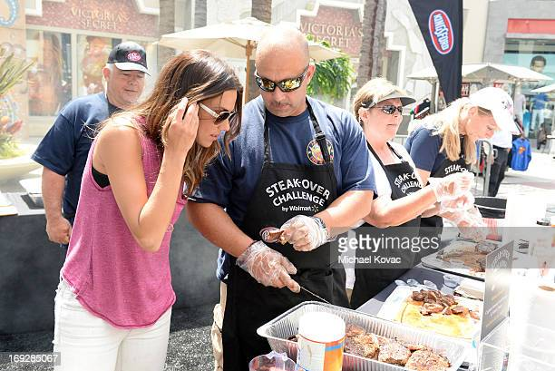 Country music star Jana Kramer talks to Steve 'SteveO' Owen with the Atlanta Fire Rescue Department about his Walmart USDA Choice steak recipe during...