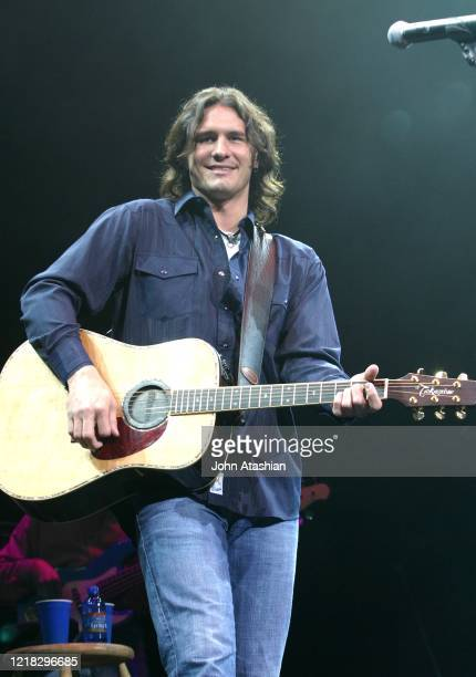 Country music star Joe Nicholas is shown performing on stage during a live concert appearance on September 19, 1993.