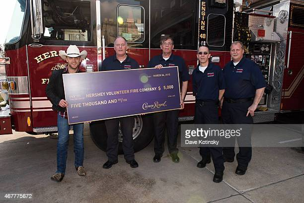 Country music star Justin Moore presents a donation to the Hershey Volunteer Fire Company on behalf of Crown Royal prior to his show on March 26 2015...