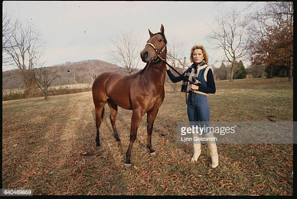 Country Music Star Tanya Tucker with a Horse