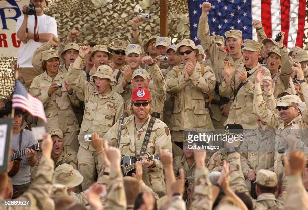 Country music star Toby Keith plays during a United Service Organizations performance May 17 2005 at Camp Victory in Baghdad Iraq Keith taped a...
