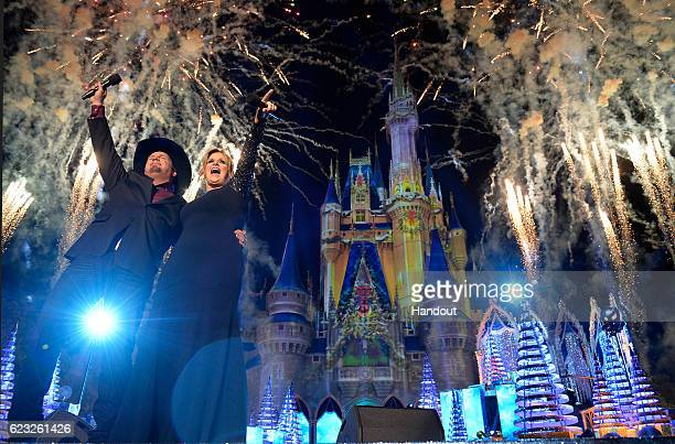 Country music stars Trisha Yearwood and Garth Brooks perform Nov 9 2016 during the taping of the ABC and Disney Channel holiday TV specials 'The...