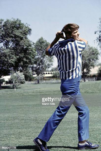 Country musician Glen Campbell watches his ball during the Bob Hope Desert Golf Classic on February 13 1971 in Palm Springs California
