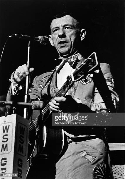 Country musician Hank Snow performs onstage at the Grand Ole Opry in Nashville Tennessee in circa 1955