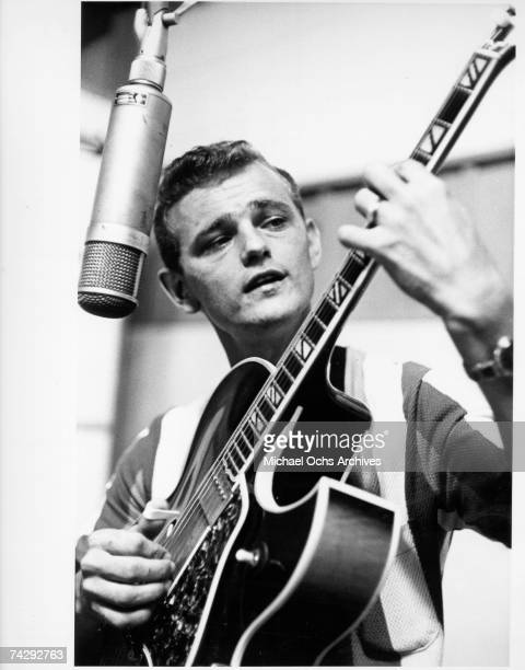 Country musician Jerry Reed plays a hollow-body electric guitar as he records in the studio in circa 1960.