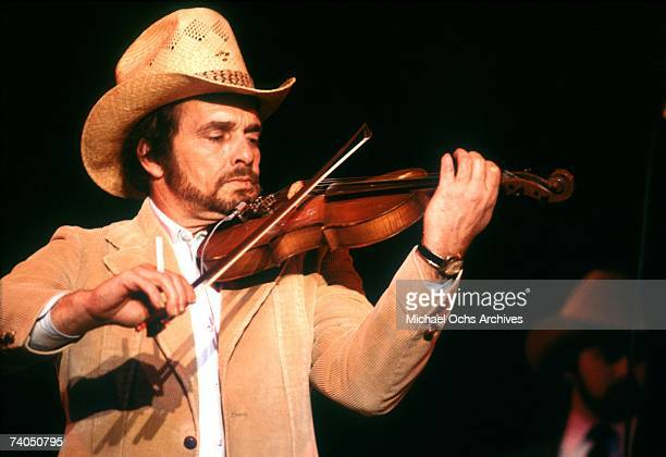 Country musician Merle Haggard performs on stage during a March 1980 concert in Los Angeles California