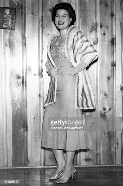 Country musician Patsy Cline poses for a portrait wearing a fur coat in circa 1958