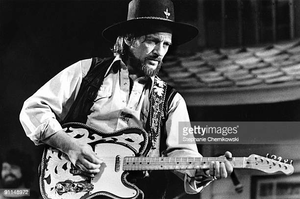 Country musician Waylon Jennings performs onstage with his Fender Telecaster electric guitar wearing a leather vest and cowboy hat in circa 1979 in...