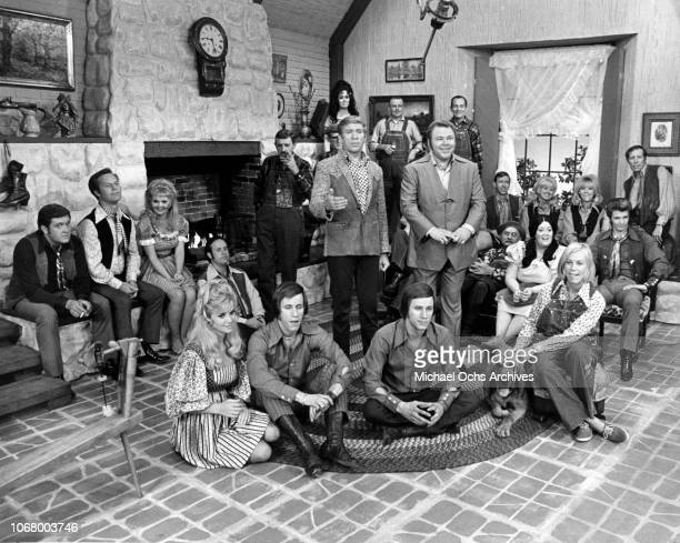 """Country musicians Buck Owens and Roy Clark with fellow cast memebers of the TV show """"Hee Haw"""" in circa 1969."""