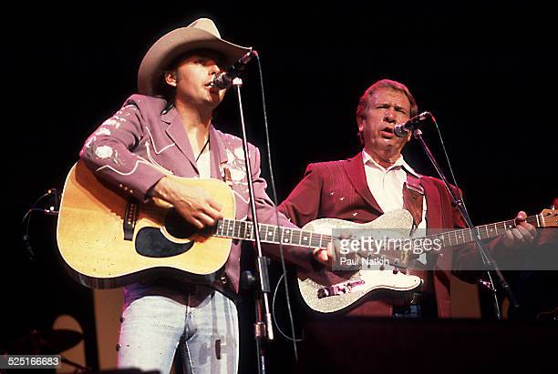 Country musicians Dwight Yoakam and Buck Owens perform together at the Chicago Theater, Chicago, Illinois, August 5, 1988.
