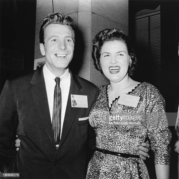 Country musicians Ferlin Husky and Patsy Cline pose for a portrait at an event in circa 1960 in Nashville Tennessee