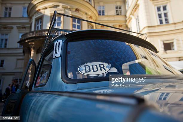 A country plate with sign DDR is placed on the Trabantbrand car at a commemoration event to the 25th anniversary of refugee exodus from communist...