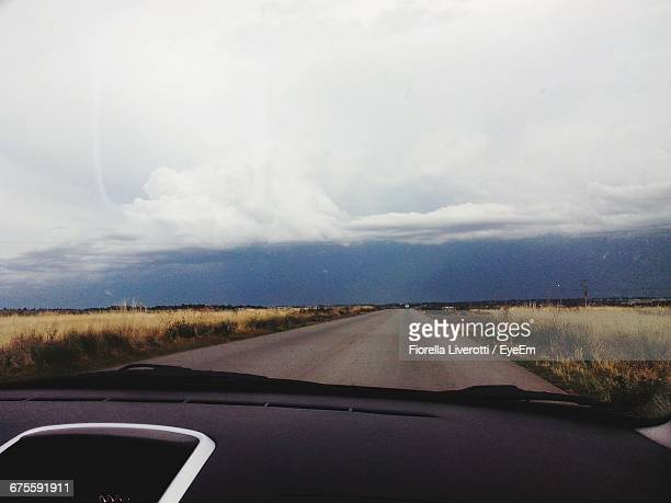 Country Road Against Sky Seen Through Car Windshield