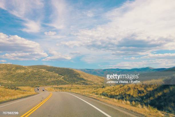 country road along landscape - janessa stock pictures, royalty-free photos & images