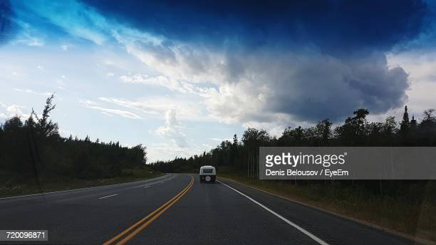 country road along landscape - kenora stock pictures, royalty-free photos & images