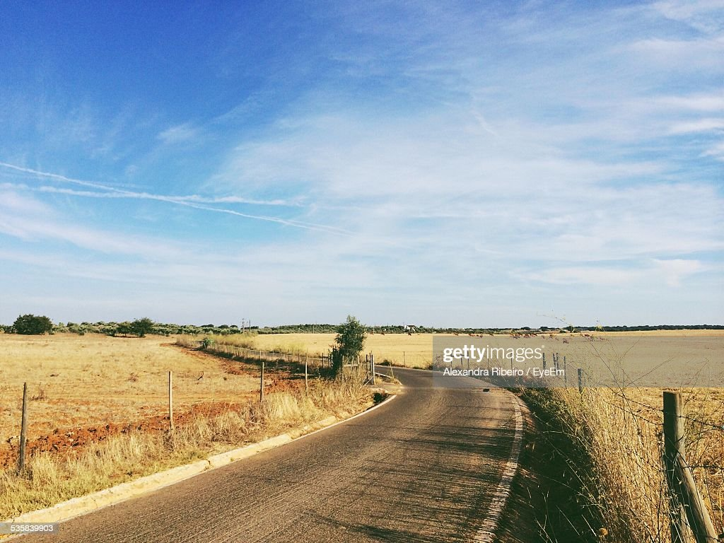 Country Road Amidst Field : Stock Photo