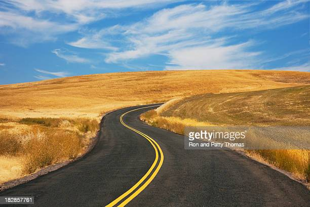 country road and wheat fields - spokane stock pictures, royalty-free photos & images