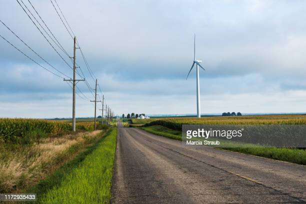 country road and wind turbine - illinois stock pictures, royalty-free photos & images
