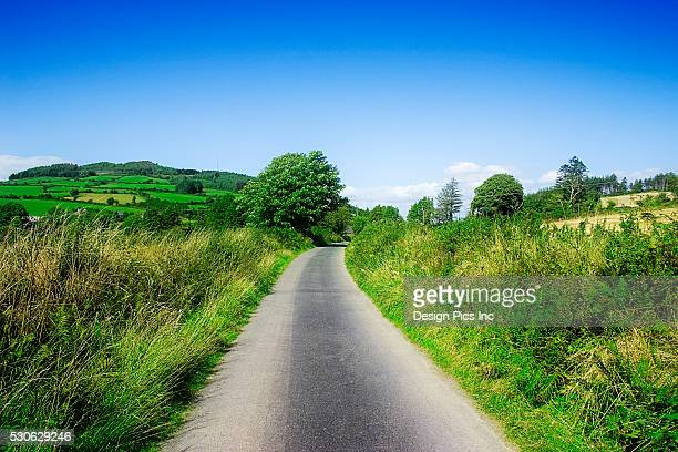 country road at cuilcagh cross roads in northern ireland - county fermanagh stock photos and pictures
