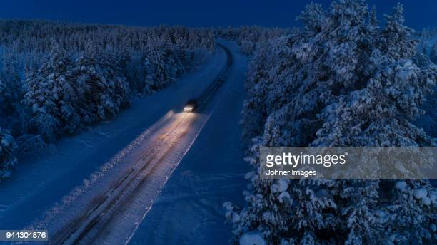 country road at winter - swedish lapland stock photos and pictures