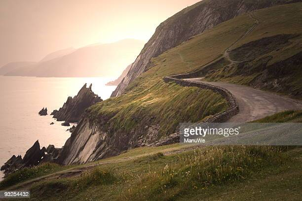 country road in irland sunset - sonnig stock pictures, royalty-free photos & images