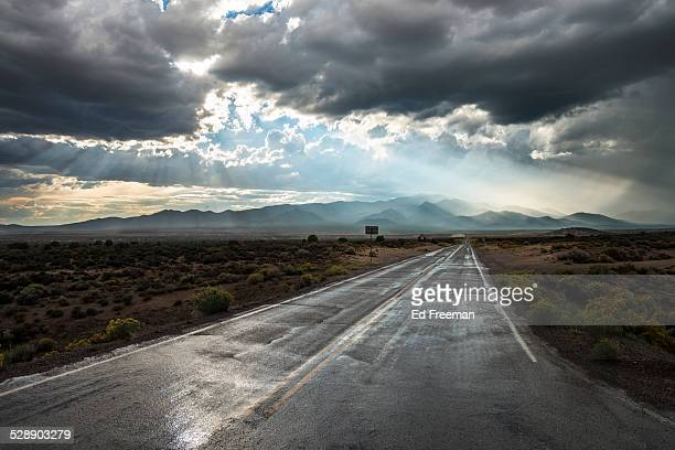 country road in rainstorm - dramatic sky stock pictures, royalty-free photos & images