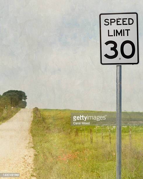country road in springtime - speed limit sign stock photos and pictures