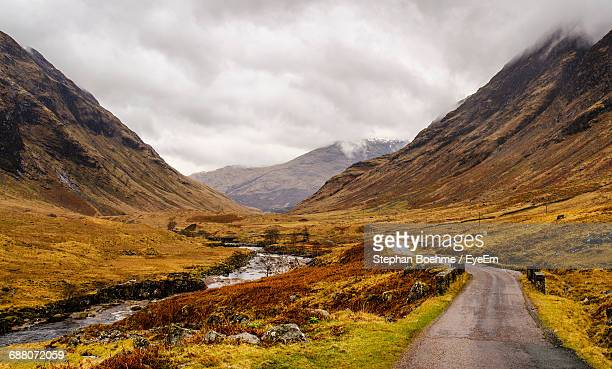 Country Road Passing Through Mountains In Glen Etive, Scotland